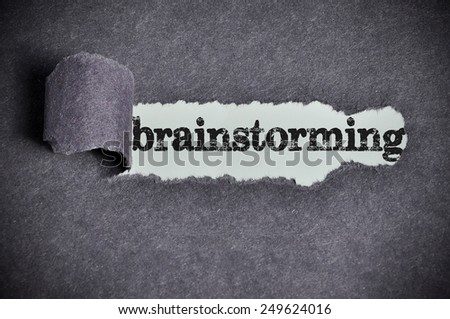 brainstorming word under torn black sugar paper  - stock photo