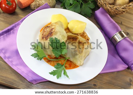 braised cabbage roulade with potatoes on a napkin - stock photo