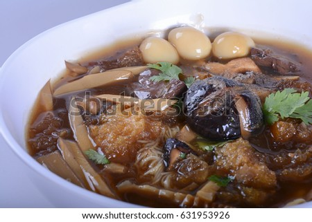 Braised Fish Maw in Red Gravy with crab in bowl on white background.