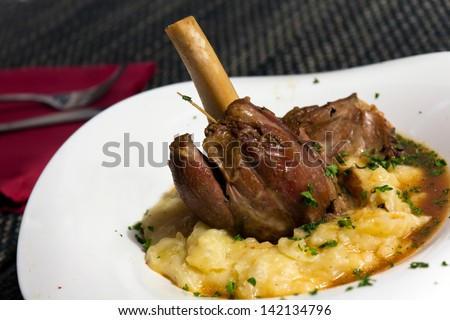 Braised lamb shank in mint and rosemary gravy, with Puree - stock photo