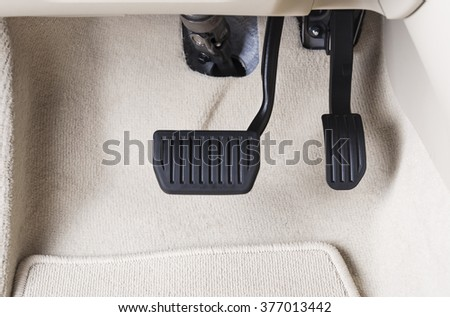 Brake and accelerator pedal of automatic transmission car in white interior - stock photo