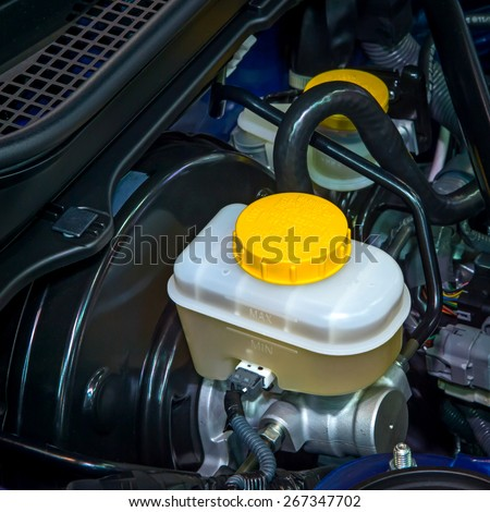 Brake and clutch fluid check cap with yellow cap and yellow warning information. - stock photo