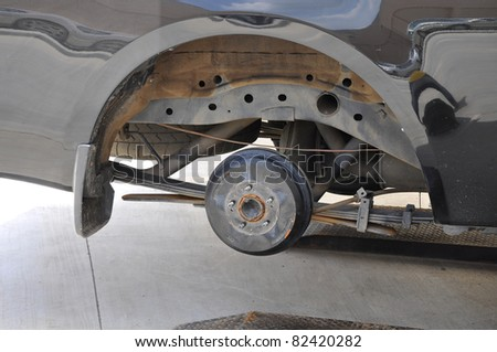 brake disk and detail of the wheel assembly - stock photo