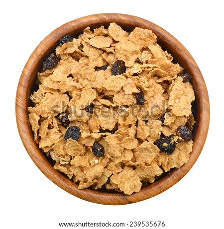 bran and raisin cereal in a wood bowl , top view  - stock photo
