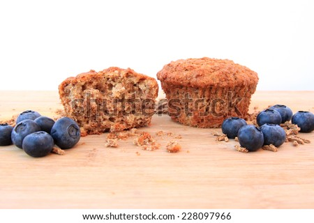 Bran muffin with blueberries on wooden background - stock photo