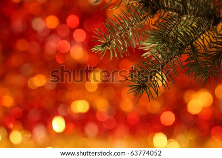 Branch of Christmas tree against red light background - stock photo