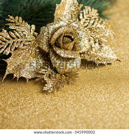 branch of Christmas tree with decoration rose - stock photo