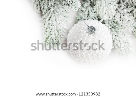 branch of Christmas tree with snow and ball - stock photo