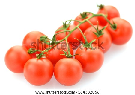 branch of fresh cherry tomatoes isolated on white background
