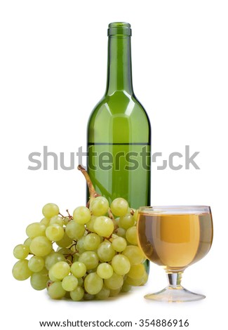Branch of grapes and bottle on white background         - stock photo