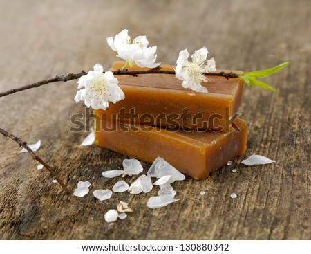 Branch of WHITE cherry blossom with soap on driftwood