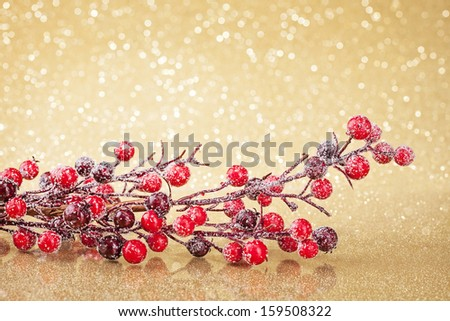 Branch wit red berries on a golden background - stock photo