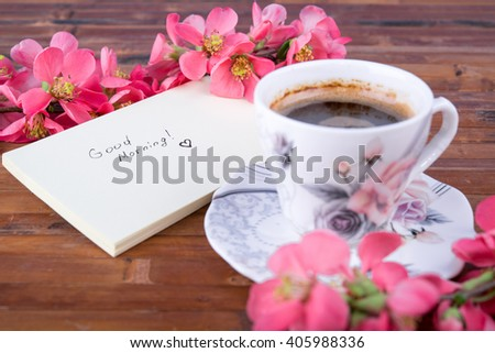 branch with cherry pink blooming flowers on aged wooden table - stock photo