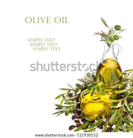 Branch with olives and a bottles of olive oil isolated on white background - stock photo