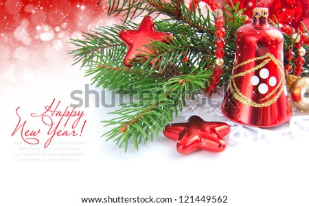 Branches of spruce are with christmas decorations on festive background - stock photo
