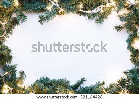 Branches of spruce with garland