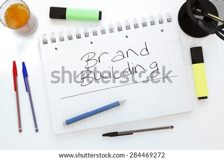 Brand Building - handwritten text in a notebook on a desk - 3d render illustration. - stock photo