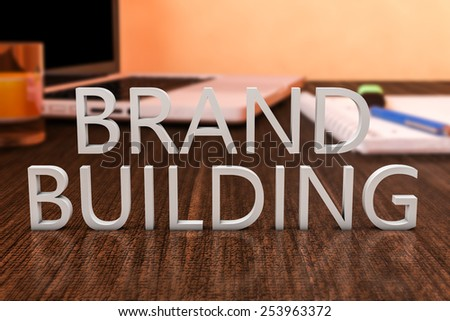 Brand Building - letters on wooden desk with laptop computer and a notebook. 3d render illustration. - stock photo