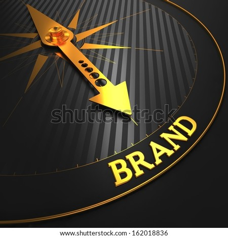 """Brand - Business Concept. Golden Compass Needle on a Black Field Pointing to the """"Brand"""" Word. - stock photo"""