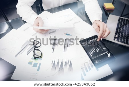 Brand Management Work Time process.Photo Trader working Market Report Documents Touching Screen Tablet.Using Graphic Icons,Stock Exchanges Reports. Business Project Startup. Horizontal, .
