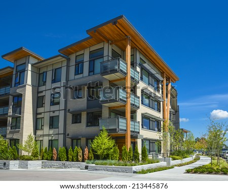 Brand new apartment building on sunny day in British Columbia, Canada. - stock photo
