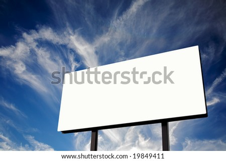 Brand new billboard and a wispy blue sky - stock photo