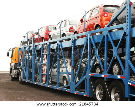 brand new cars on a car transport truck at rosario city argentina near