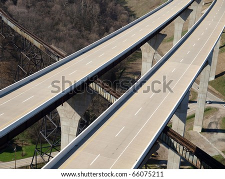 Brand new freeway bridges through forested countryside in the eastern United States. - stock photo