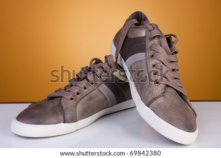 Brand new leather casual shoes. Studio shot. Artistic selective focus. - stock photo