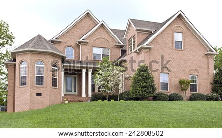 Brand New Luxury Home With Nice Landscape - stock photo