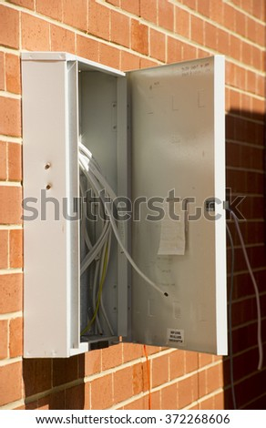 Brand new power box on wall of red brick home