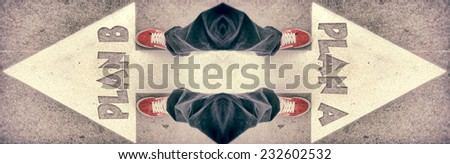 Brand new red shoes from above standing on plan A and B sign - stock photo
