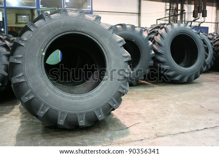 Brand new tractor tires placed on factory floor ready to be transported to tiers shop