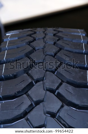 Brand new truck tire. Truck tire with brand new texture.