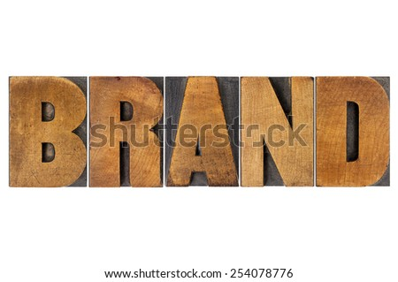 brand word in isolated letterpress wood type printing blocks - stock photo