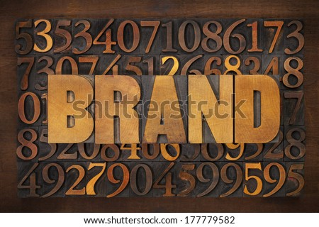 brand word in vintage letterpress wood type against number background - stock photo
