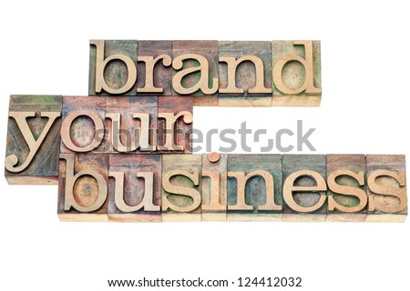 brand your business - marketing concept - isolated text in vintage letterpress wood type printing blocks - stock photo