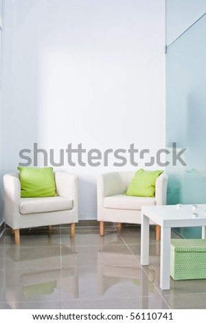 Brandable waiting room with two armchairs and white wall on the back. - stock photo