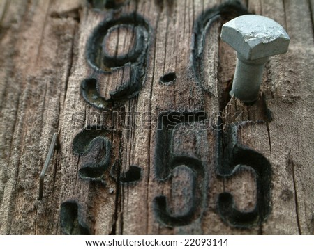 Branded numbered post with steel bolt closeup - stock photo