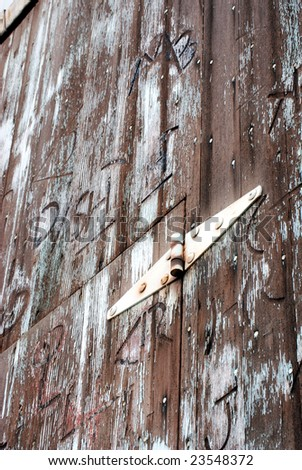 Branded western barn door shot upward from a low angle. - stock photo