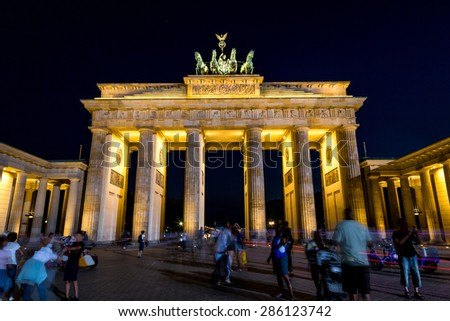 Brandenburg gate, Berlin, Germany at night. Road side view - stock photo