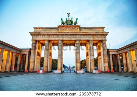 Brandenburg gate (Brandenburger Tor) in Berlin, Germany at sunrise - stock photo