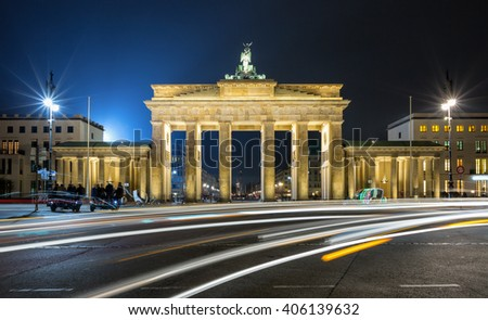 Brandenburger Tor in Berlin, Germany, by night with blurred, white traffic lights