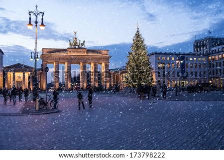 brandenburger tor in winter in berlin - stock photo