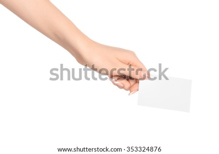 Branding and advertising theme: beautiful female hand holding a blank white paper card isolated on white background