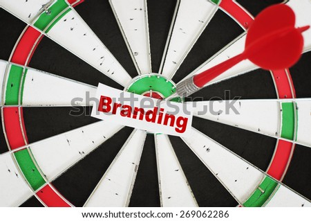 Branding Concept and a dart in center of target - stock photo