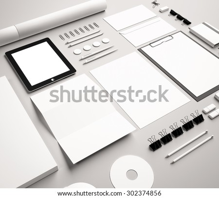 Branding Identity Mock Up. Set includes a laptop, a tube, a pencil, a tablet, a smartphone; icon; clip, business cards, pens, CD, flash card, paper clips, erasers, cup, sticker, blank, sheet A4 - stock photo