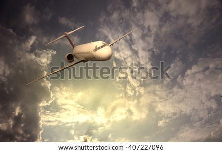 Brandless airplane flying in the clouds