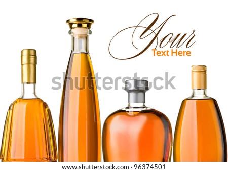 brandy bottles isolated on white background - stock photo