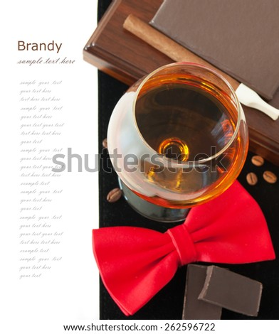 Brandy, cigar, book and coffee beans and man bow tie isolated on white background with sample text - stock photo